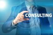 Businessman presses button consulting on virtual screens. Busine — ストック写真