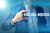 Businessman presses button social media on virtual screens. Busi — Stock Photo