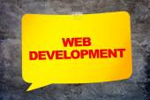 """""""Web development"""" in the yellow banner textural background. Desi — Stock Photo"""