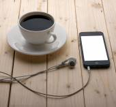 Headphones and a cup of coffee — Stock Photo