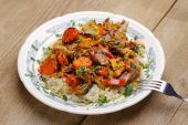 Lamb ragout with vegetables and rice in white plate — Stok fotoğraf