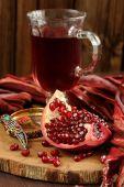 Peeled pomegranate, glass of pomegranate juice and jewerly on wo — Stock Photo