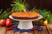 Christmas cake on white plate with fur tree, tangerine and chris — Stock Photo