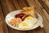 Full english breakfast with eggs, sausages, beans, toasts — Stock Photo