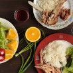 Dinner od turkey meat with rice, lettuce salad with radish, oran — Stock Photo #70925061