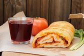 Pizza stromboli cut with glass of red wine, fresh scallion and t — Foto de Stock