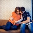 Постер, плакат: Pregnant woman with her husband