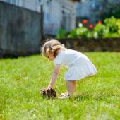 Child with a rabbit on the grass — Stock Photo