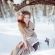 Beautiful girl in the winter forest — Stock Photo #55095567