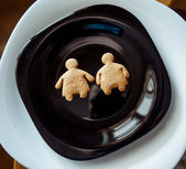 Pile of  cookies on a black plate — Stock Photo