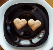 Pile of  cookies on a black plate — Stockfoto