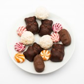 Chocolate and sugar candies over white — Stock Photo