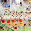 Different cakes on banquet table — Stock Photo #58133317
