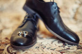 Black men shoes and wedding rings — Stock Photo