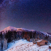 Fantastic winter meteor shower and the snow-capped mountains — Stock Photo