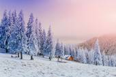 Sunset in the winter mountains and fantastic chalet — Fotografia Stock