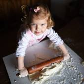 Photo of  baker adorable, pretty little caucasian girl in chef.  — Stock Photo