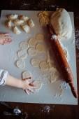 Child knead dough — Stock Photo