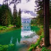 Mountain lake between by mountains — Stock Photo