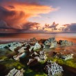 Sunset at coast of the sea with stones — Stock Photo #69326581