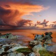 Sunset at coast of the sea with stones — Stock Photo #69326659