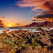 Sunset at coast of the sea with stones — Stock Photo #69327039