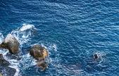 Noisy sea with stones — Stock Photo
