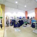 Brand new interior of kids cloth store — Stock Photo #60279273