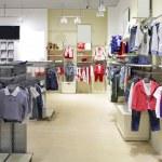 Brand new interior of kids cloth store — Stock Photo #60279479