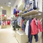 Brand new interior of kids cloth store — Stock Photo #60279523