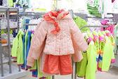 Brand new interior of kids cloth store — Stockfoto