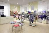 Brand new interior of kids cloth store — Stock Photo
