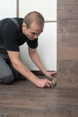 Install baseboards — Stock Photo