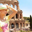 Happy Tourist and Coliseum, Rome. Cheerful Young Blonde Woman — Stock Photo #52142765