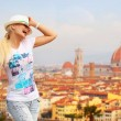 Happy Tourist in Florence. Cheerful Young Blonde Woman with Map — Stock Photo #52142827