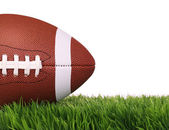 American Football. Ball on Green Grass, isolated on white — Stock Photo