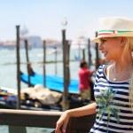 Happy Tourist and Gondolas in Venice, Italy. Cheerful Blonde — Stock Photo #54517207