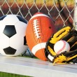Sport balls. Soccer ball, american football and baseball in yell — Stock Photo #54517229