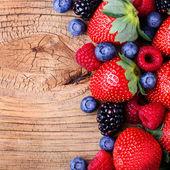 Berries on Wooden Background. Strawberries, Blueberry, Raspberri — Stock Photo