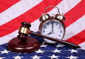 Judge Gavel and Alarm Clock over American Flag — Foto de Stock