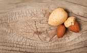 Almonds on old wooden background — Stock Photo