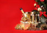 Christmas or New Year's Eve. Champagne and Presents over Red — Stock Photo