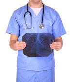 Doctor with stethoscope examining x-ray photos isolated on white — Stock Photo