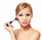 Beautiful woman with makeup brush isolated on white. Blonde girl — Stock Photo