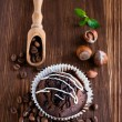 Chocolate muffins with hazelnuts and coffee beans  — Stock Photo #57759259