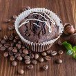Chocolate muffins with hazelnuts and coffee beans  — Stock Photo #57759277