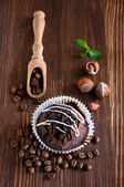 Chocolate muffins with hazelnuts and coffee beans  — Stock Photo
