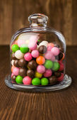 Colorful candies in a glass bell — Stock Photo