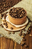 Roasted coffee beans in wooden bowl — Stock Photo