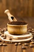 Ground coffee beans in a wooden bowl — Stock Photo